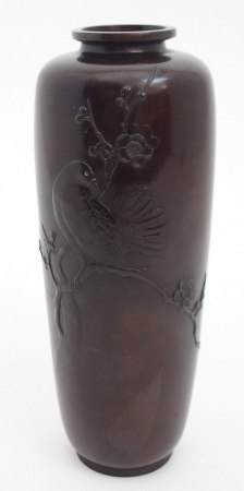 A JAPANESE BRONZE BALUSTER VASE cast with pigeon perched on blossoming branches, seal mark to