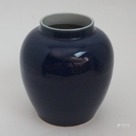 A CHINESE BLUE GROUND JAR incised with peonies and scrolling foliage, six character mark, 23cm