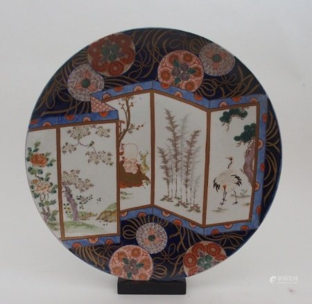 AN IMARI CHARGER painted with a five section screen with a scholar and deer, red capped cranes,