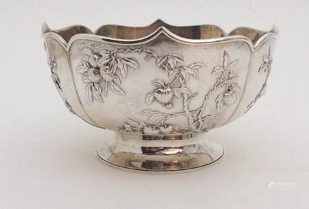 A CHINESE SILVER LOBED BOWL decorated with panels of fruit, beneath a folded rim and stamped, ZEEWO