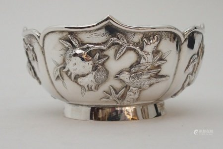 A CHINESE SILVER LOBED SUGAR BOWL decorated with panels of birds amongst fruit trees and foliage,