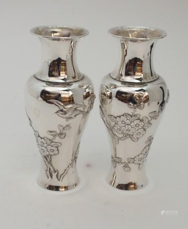 A PAIR OF CHINESE SILVER BALUSTER VASES decorated with birds amongst flowering branches, stamped