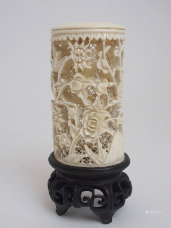 A CANTON CARVED IVORY TUSK decorated with birds amongst flowers and foliage on a trellis pattern