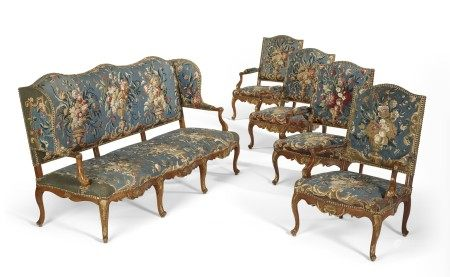 A SUITE OF EARLY LOUIS XV PARCEL-GILT WALNUT SEAT FURNITURE