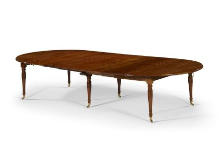 AN EMPIRE MAHOGANY EXTENSION DINING TABLE