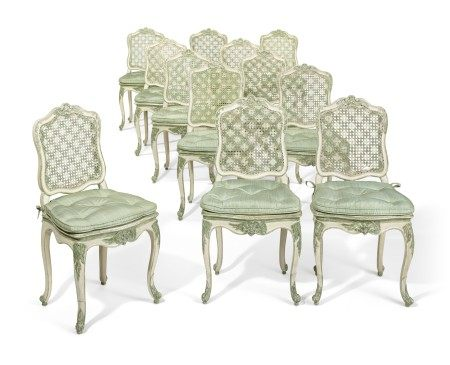 A SET OF TWELVE LOUIS XV GREEN AND WHITE-PAINTED CANED CHAISES