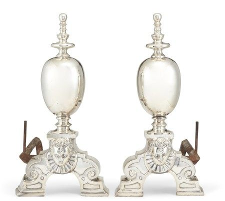 A PAIR OF BAROQUE STYLE SILVERED ANDIRONS