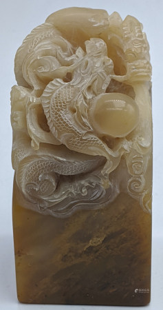 A Chinese soapstone carving in the form of a dragon chasing the pearl, 332g, H.7.5cm