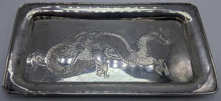 A Chinese silver pin dish, dragon embossed to lid, gilt interior, raised on three paw feet, marked
