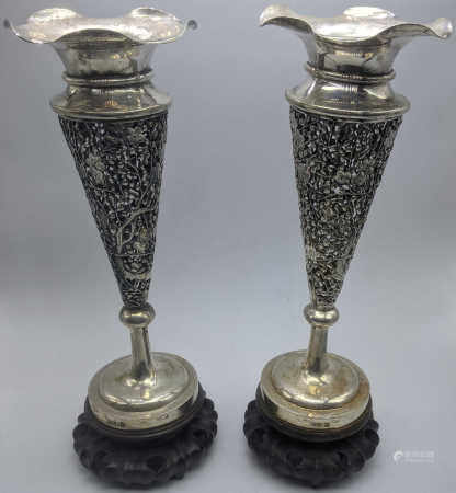 A pair of late 19th century silver Chinese export vases, pierced floral bodies, raised on hardwood