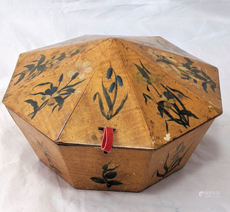 A 19th century octagonal wooden turban box, decorated with floral designs on each panel, probably