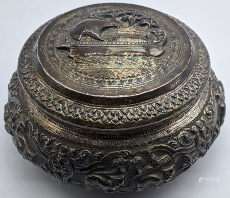A Burmese silver box, embossed with a ship to the lid, scenes to the middle of elephants, cows and