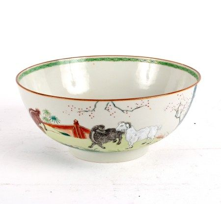 A Chinese export famille rose punch bowl, decorated the three rams before terracing and shrubs,