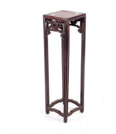 A small Chinese hardwood stand on square supports,