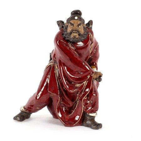 A Chinese pottery figure by Liu Zemian of Zhong Kui driving away devils,