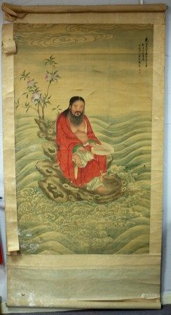 A Qing Chinese ancestral portrait of a kneeling sage wearing a red mandarin jacket, on linen,