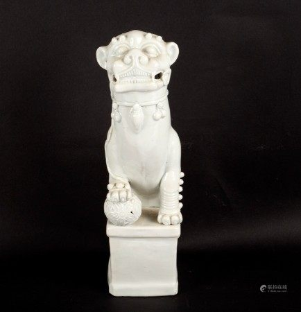 A blanc-de-chine figure of a dog of fo,