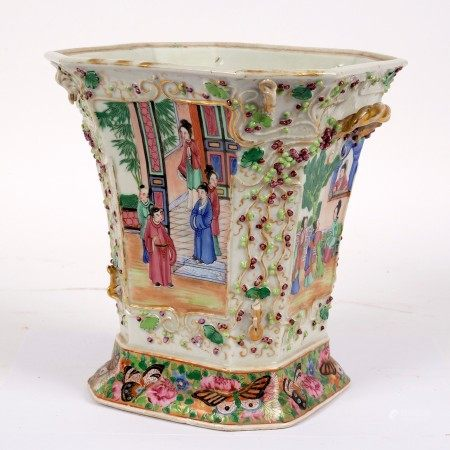 A Cantonese square-shaped, two-handled vase with flanged top, enamelled figures in reserves,