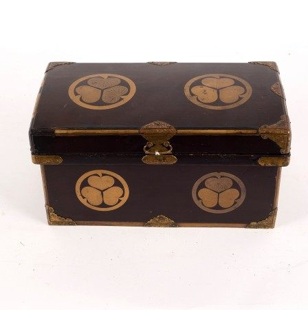 A 19th Century brown lacquered box painted gilded trefoil foliate circles and with embossed gilded
