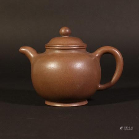 dark-red enameled pottery teapot