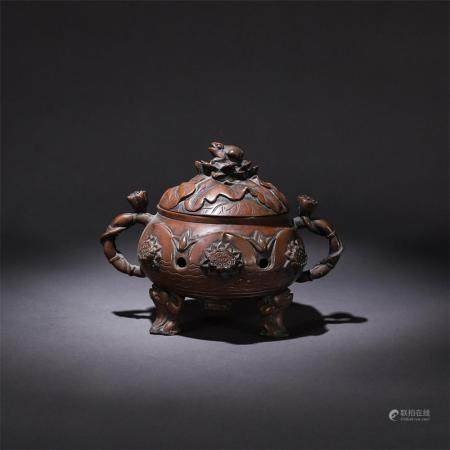 A FINELY OPENWORKED RED COPPER BURNER