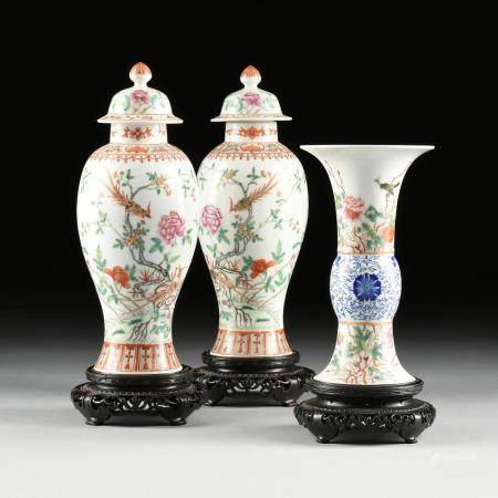 A THREE PIECE CHINESE FAMILLE ROSE LIDDED URNS AND GU VASE G