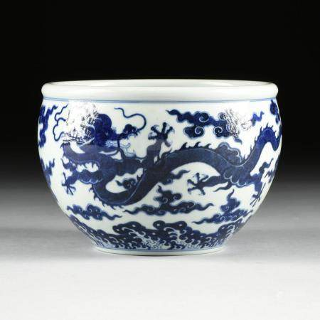 A CHINESE BLUE AND WHITE DRAGON PORCELAIN PLANTER, QIANLONG