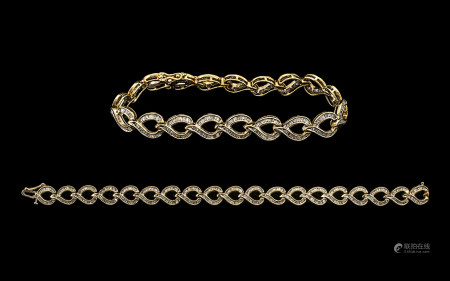 Ladies - Attractive 10ct Gold Baguette Diamond Set Tennis Bracelet of Contemporary Design. Marked