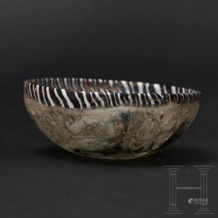 A late Hellenistic/early Roman glass bowl with floral décor in pigment coating between double w
