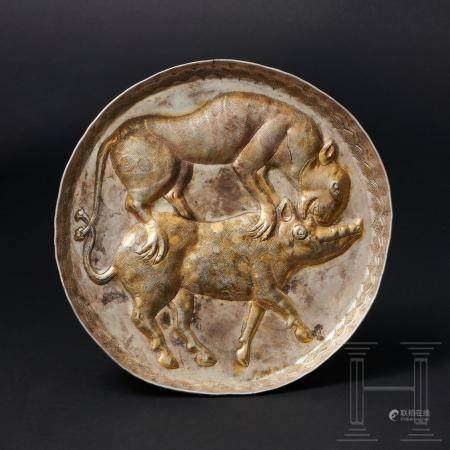 A rare Avaric, partly gilt silver plate with animal fighting scene, Pannonia, circa 8th century