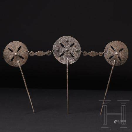 A rare set of three linked Anglo Saxon silver dress pins, England, 8th 9th century
