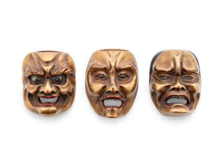 Three Gilt Lacquered Wood Mask Netsukes
