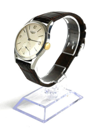 LONGINES, A VINTAGE STAINLESS STEEL GENT'S WRISTWATCH Having a silver tone dial with Arabic
