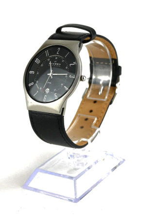 SKAGEN, A DANISH STAINLESS STEEL GENT'S WRISTWATCH Having a circular black dial with Arabic number