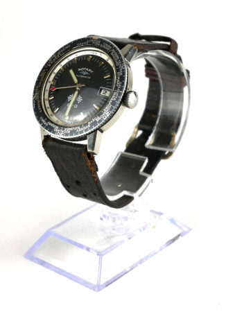 ROTARY, GTO, A VINTAGE STAINLESS STEEL GENT'S WRISTWATCH Black circular dial with world time bezel