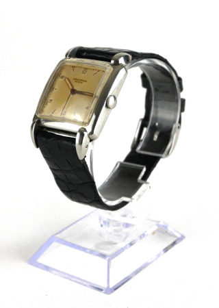 UNIVERSAL, AN EARLY 20TH CENTURY STAINLESS STEEL GENT'S WRISTWATCH Art Deco square form dial and