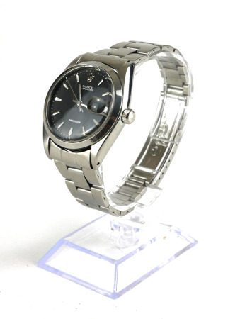 ROLEX, OYSTER DATE, A STAINLESS STEEL GENT'S WRISTWATCH Circular black dial with steel number