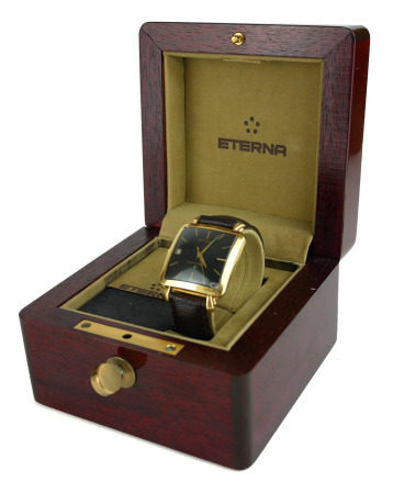 ETERNA-MATIC CENTENAIRE, A VINTAGE 18CT GOLD WATCH With square dial, calendar, automatic, brown