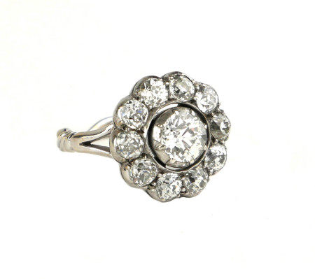 A VICTORIAN 18CT GOLD AND 4CT OLD CUT DIAMOND DAISY CLUSTER RING. (colour H) (clarity SI)