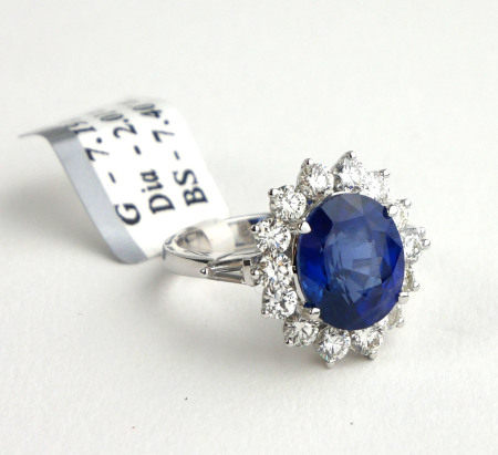 AN 18CT WHITE GOLD, 7.4CT OVAL CUT SAPPHIRE AND 2.01CT ROUND BRILLIANT CUT DIAMOND RING (SIZE P).