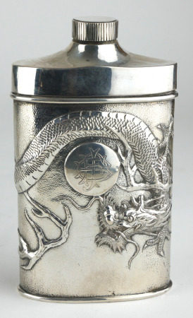 A CHINESE SILVER SPIRIT FLASK Entwined in relief with a four toed dragon. (13cm)