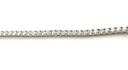 AN 18CT WHITE GOLD AND ROUND BRILLIANT CUT DIAMOND TENNIS BRACELET (diamond weight 5.11ct) (19.5cm)