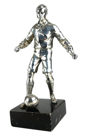 AN EARLY 20TH CENTURY SILVER PLATED STATUE OF A FOOTBALLER. (28.7cm)
