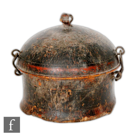 A 19th Century Tibetan bretel nut box, the painted wooden circular box, with primative metal hinge