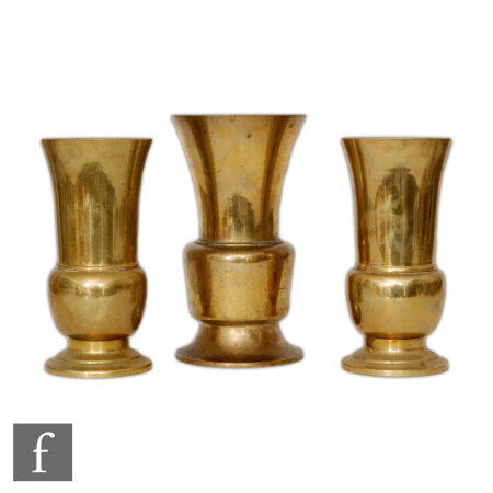 A set of three Chinese late Qing Dynasty (1644-1912) Gu beaker vases, each rising from a spreading