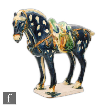 A Tang Dynasty style horse modelled in standing position, with blue glazes picked out in green and