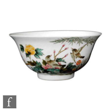 A Chinese famille rose bowl, Qianlong (1736-95) seal mark, but later, the white glazed footed bowl