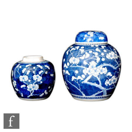 Two 18th/19th Century Chinese blue and white 'Prunus' jars, the first of rounded form with domed
