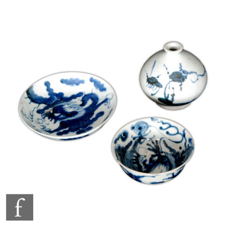 A collection of Chinese blue and white porcelain items, to include a squat form bottle vase, loosely
