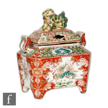 A 19th Century Chinese enamelled censer of rectangular form, raised on pad supports, the reticulated